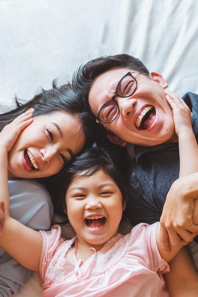 happy parents and young daughter